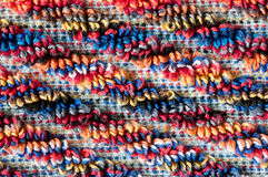 Terrycloth towel, close up. Close up of colorful diagonal frottee pattern, colorfol red, orange, blue Royalty Free Stock Images