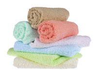 Terrycloth towels arranged in a stack on white background Stock Photos