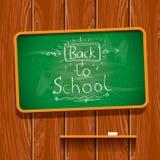 Terug naar school, die op bord chalkwriting Royalty-vrije Stock Foto's