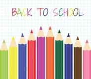 Terug naar School Een reeks kleurpotloden op een achtergrond van nota Stock Afbeelding