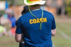 Terug van een overhemd van de bus` s blauw kleur met de woordbus in geel Royalty-vrije Stock Foto's