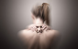 Terug van een vrouw die hals op pijn wijzen Stock Foto