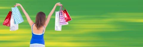Terug van klant met zakken in lucht tegen onscherpe groene achtergrond Royalty-vrije Stock Afbeeldingen