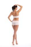 Terug van mooie vrouw met gestemd geschikt lichaam Stock Foto