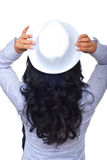 Terug van vrouw met krullende haar en hoed Stock Afbeeldingen