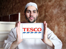 Tesco logo. Logo of the international chain of convenience stores tesco on samsung tablet holded by arab muslim man Royalty Free Stock Photos