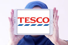 Tesco logo. Logo of the international chain of convenience stores tesco on samsung tablet holded by arab muslim woman Royalty Free Stock Image