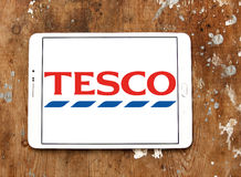 Tesco logo. Logo of the international chain of convenience stores tesco on samsung tablet on wooden background Royalty Free Stock Photography