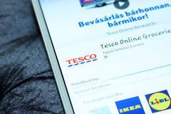 Tesco mobile app. Downloading the international chain of convenience stores tesco from google play store on samsung tablet Royalty Free Stock Images