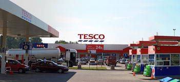 Tesco and petrol station panorama. Tesco supermarket and petrol station in Warsaw in Poland.Tesco is a global grocery and general merchandise retailer royalty free stock photo