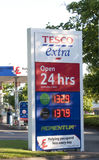 Tesco's Petrol Sign. Tesco's petrol sigh displaying opening times, price and petrol sold royalty free stock photo