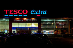 Tesco Store at Night. A 24 Hour Tesco Extra store at night showing typical Tesco branding and messages Royalty Free Stock Image