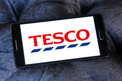 Tesco stores logo. Logo of the international chain of convenience stores tesco on samsung mobile phone a5 Royalty Free Stock Photo