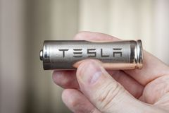 Tesla 2170 Battery lithium ion Cells pack, in human hand. stock photography