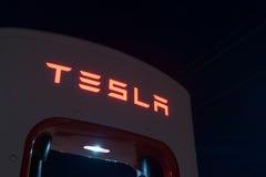 Tesla battery recharge station Shamrock Texas USA. Night image brand name on illuminated Tesla battery recharge station for recharging the electric cars of same stock image
