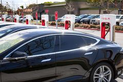 Tesla charging station pumps stock photo