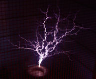 Tesla Coil. Throwing man-size sparks in a Faraday cage Stock Photography