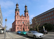 Tesla Electric car passing by Old  Kirche St Peter Church Royalty Free Stock Photography