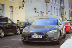 Tesla electric Car on the street. TALLINN/ESTONIA - JUNE 14, 2015: Tesla electric Car on the street of the old town, Tallinn, Estonia Royalty Free Stock Photography