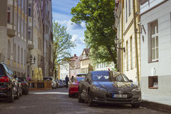 Tesla electric Car on the street. TALLINN/ESTONIA - JUNE 14, 2015: Tesla electric Car on the street of the old town, Tallinn, Estonia Stock Photos
