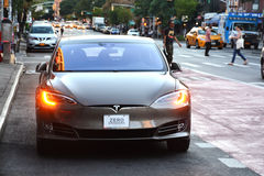 Tesla electric car with ZERO EMISSIONS text on the license plate waiting in traffic Stock Photography