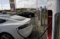 TESLA ELECTRIC VEHICLES. Rodekro /Jylland _Denmark _22..April 2017_Tesla electric been rechared at Tesla electric recharge booth in Rodekro Jylland Denmark Royalty Free Stock Image