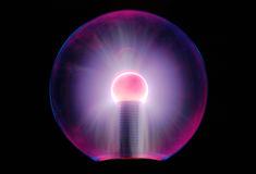 Tesla energy ball turned on light over long exposure. Eletric tesla ball light over black background long exposure royalty free stock photos