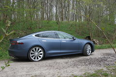 Tesla in the forest. Photo shot where I mixed the design of the Tesla with beautiful nature royalty free stock photos