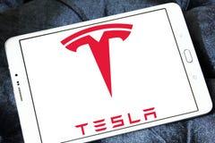 Tesla logo. Logo of tesla company on samsung tablet. tesla is an American automaker, energy storage company, and solar panel manufacturer Stock Photos