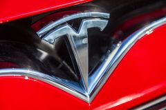 Tesla logo on a Tesla car. FUERTH / GERMANY - MARCH 4, 2018: Tesla logo on a Tesla car Tesla, Inc. is an American company that specializes in electric stock image