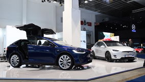 Tesla Model X all-electric, luxury, crossover SUV car with opening doors. Tesla Model X all-electric, luxury, crossover SUV car with open doors and a man getting stock video