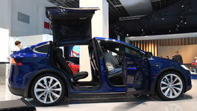 Tesla Model X all-electric, luxury, crossover SUV car with opening doors. Tesla Model X all-electric, luxury, crossover SUV car with open doors and a man is stock footage