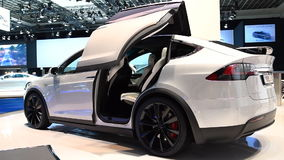 Tesla Model X all-electric, luxury, crossover SUV car with opening doors. Tesla Model X all-electric, luxury, crossover SUV car with two women stepping out of stock footage