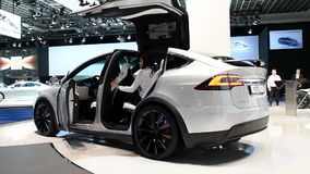 Tesla Model X all-electric, luxury, crossover SUV car. With two women stepping into the car during the 2017 European Motor Show Brussels stock video footage
