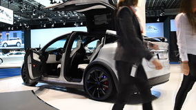 Tesla Model X all electric, luxury, crossover SUV car. With two women stepping out of the car during the 2017 European Motor Show Brussels stock video