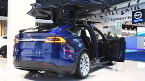 Tesla Model X 90D all electric, luxury, crossover SUV. Car with open doors during the 2017 European Motor Show Brussels stock footage