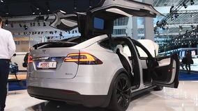 Tesla Model X 90D all electric, luxury, crossover SUV. Car with open doors during the 2017 European Motor Show Brussels stock video