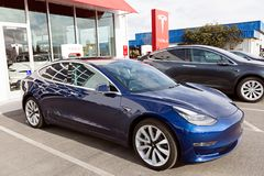 Tesla model 3 new electric car. Seaside, CA - January 6, 2018: newest navy tesla model 3 charging at supercharger station Royalty Free Stock Photo