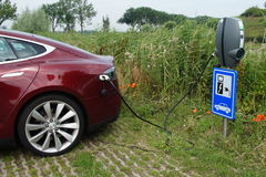 Tesla Model S being charged Royalty Free Stock Image