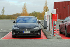 Tesla Model S Cars Plugged In at Supercharger Station Royalty Free Stock Photography
