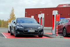 Tesla Model S Cars at a Supercharger Station Stock Image