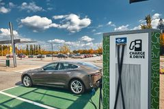 Tesla Model S at a Charging Station stock photography