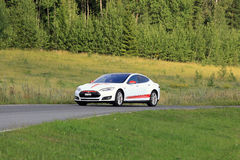 Tesla Model S Electric Car and Green Rural Road Stock Photos