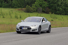 Tesla Model S Electric Car on Summer Road Royalty Free Stock Photography