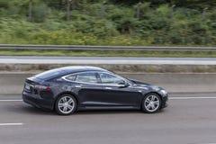 Tesla Model S on the highway Stock Photography