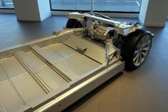 Tesla plug-in electric car chassis and battery Stock Image