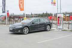 Tesla power charger. ARBOGA, SWEDEN - MARCH 22, 2015: Tesla power charger. Tesla Motors Inc, electric car being charged in one of the stations between Stockholm Royalty Free Stock Photos