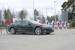 Tesla power charger. ARBOGA, SWEDEN - MARCH 22, 2015: Tesla power charger. Tesla Motors Inc, electric car being charged in one of the stations between Stockholm Royalty Free Stock Images