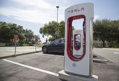 Tesla recharging station on Florida Turnpike Stock Photo