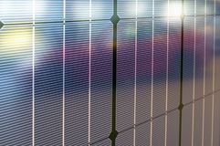 Tesla solar panels with reflection of the plug-in electric car M Stock Photography